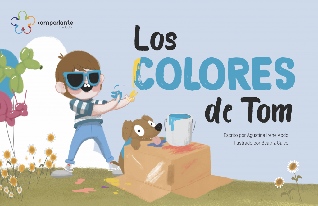 """Cover of the story """"Los Colores de Tom"""", winner story of the First Prize at the International Literary Contest """"My World My Way, First Edition"""". The main character appears with his hands full of paint, his guide-dog and some flowers. In addition to the name of the story, appear the names of the writer, the illustrator and the logo of Fundación Comparlante."""