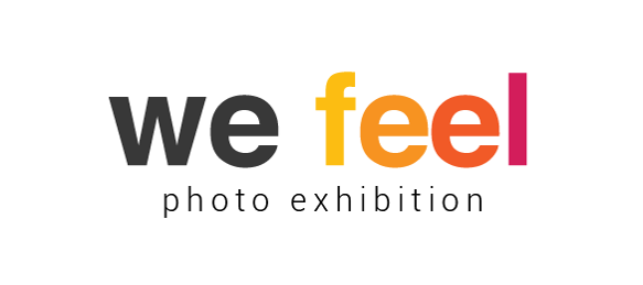 """Logo of the photographic exhibition We Feel. The letters of """"We"""" in black color while the letters of the word """"Feel"""" change, from left to right, from yellow to orange and purple."""